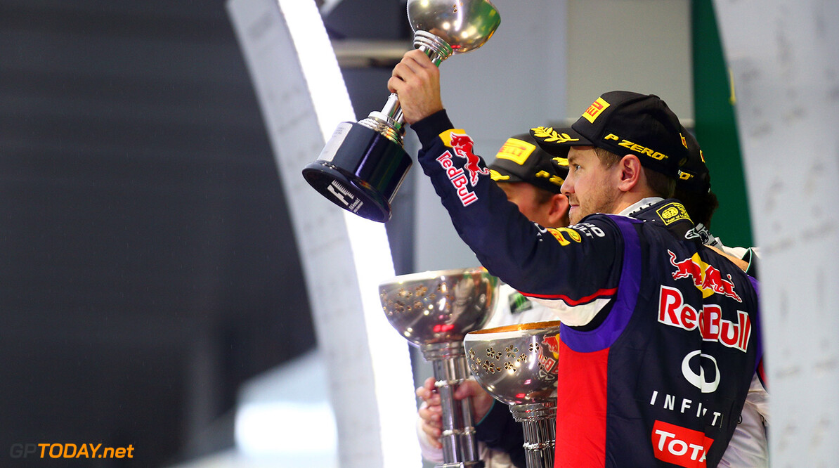 SUZUKA, JAPAN - OCTOBER 05:  Sebastian Vettel of Germany and Infiniti Red Bull Racing celebrates following his thrid place during the Japanese Formula One Grand Prix at Suzuka Circuit on October 5, 2014 in Suzuka, Japan.  (Photo by Mark Thompson/Getty Images) *** Local Caption *** Sebastian Vettel F1 Grand Prix of Japan Mark Thompson Suzuka Japan