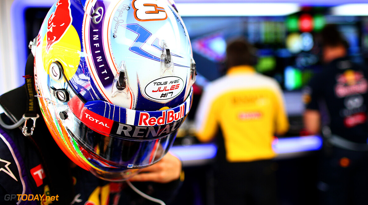 SOCHI, RUSSIA - OCTOBER 10:  Daniel Ricciardo of Australia and Infiniti Red Bull Racing's helmet displaying the message 'tous avec Jules #17' in support of Jules Bianchi of France and Marussia following his accident at Suzuka during practice ahead of the Russian Formula One Grand Prix at Sochi Autodrom on October 10, 2014 in Sochi, Russia.  (Photo by Mark Thompson/Getty Images) *** Local Caption *** Daniel Ricciardo F1 Grand Prix of Russia - Practice Mark Thompson Sochi Russia  formula one racing