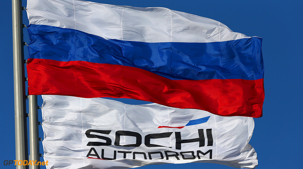 SOCHI, RUSSIA - OCTOBER 09:  The Sochi Autodrom flag flaps in the wind next to the Russian national flag during previews ahead of the Russian Formula One Grand Prix at Sochi Autodrom on October 9, 2014 in Sochi, Russia.  (Photo by Clive Mason/Getty Images) F1 Grand Prix of Russia - Previews Clive Mason Sochi Russia  formula one racing