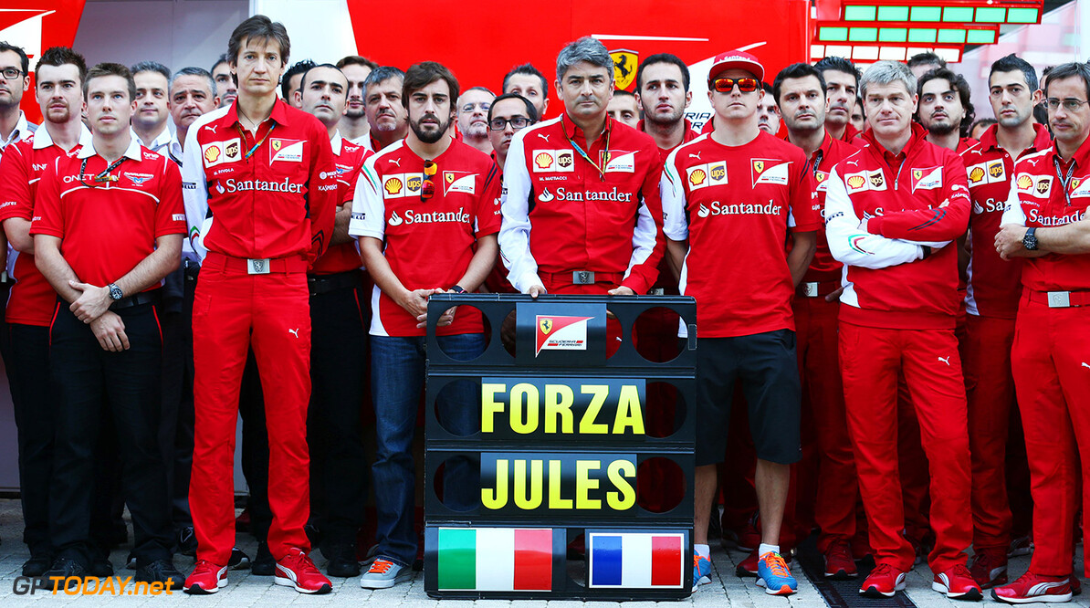 Formula One World Championship (L to R): Massimo Rivola (ITA) Ferrari Sporting Director; Fernando Alonso (ESP) Ferrari; Marco Mattiacci (ITA) Ferrari Team Principal; Kimi Raikkonen (FIN) Ferrari and members of the Ferrari and Marussia F1 Team show their support for Jules Bianchi.