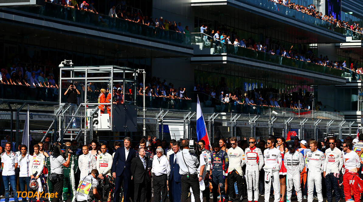SOCHI, RUSSIA - OCTOBER 12:  The drivers observe a short silence for Jules Bianchi of France and Marussia following his accident at Suzuka during the Russian Formula One Grand Prix at Sochi Autodrom on October 12, 2014 in Sochi, Russia.  (Photo by Dan Istitene/Getty Images) F1 Grand Prix of Russia Dan Istitene Sochi Russia  formula one racing