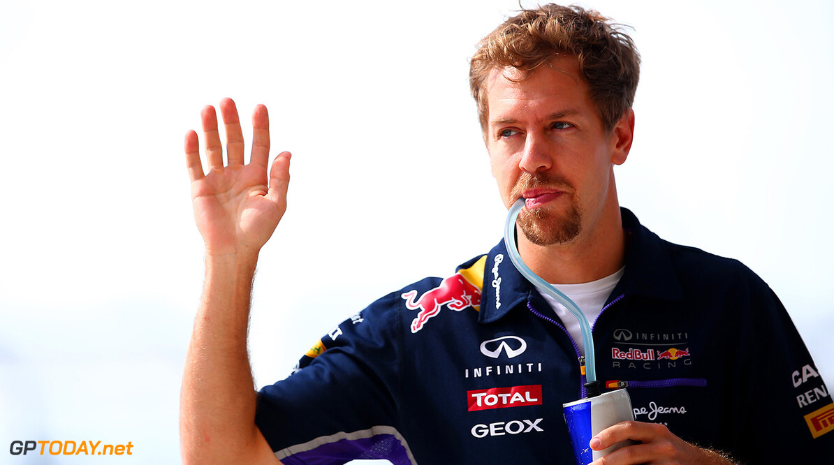 AUSTIN, TX - NOVEMBER 02:  Sebastian Vettel of Germany and Infiniti Red Bull Racing leaves the drivers' parade before the United States Formula One Grand Prix at Circuit of The Americas on November 2, 2014 in Austin, United States.  (Photo by Mark Thompson/Getty Images) *** Local Caption *** Sebastian Vettel F1 Grand Prix of USA Mark Thompson Austin United States  forumla one racing shellf1gp
