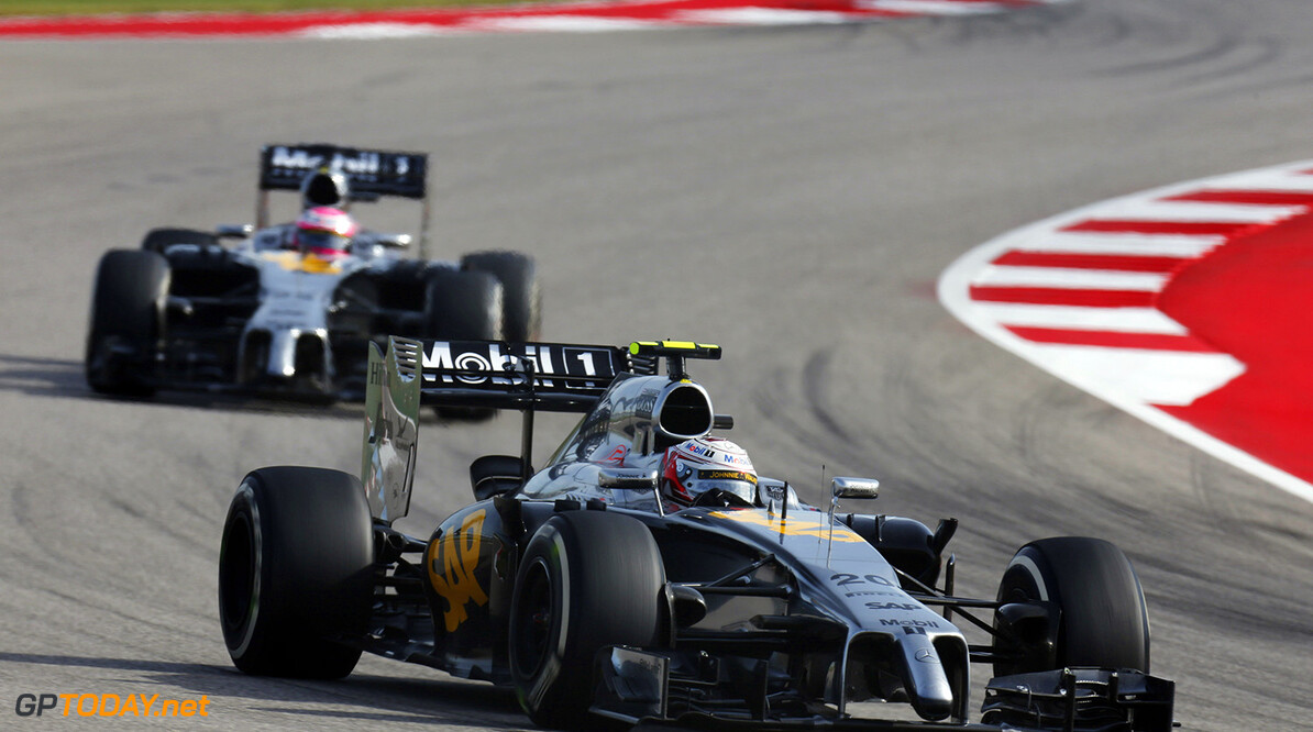 Kevin Magnussen leads Jenson Button not track.