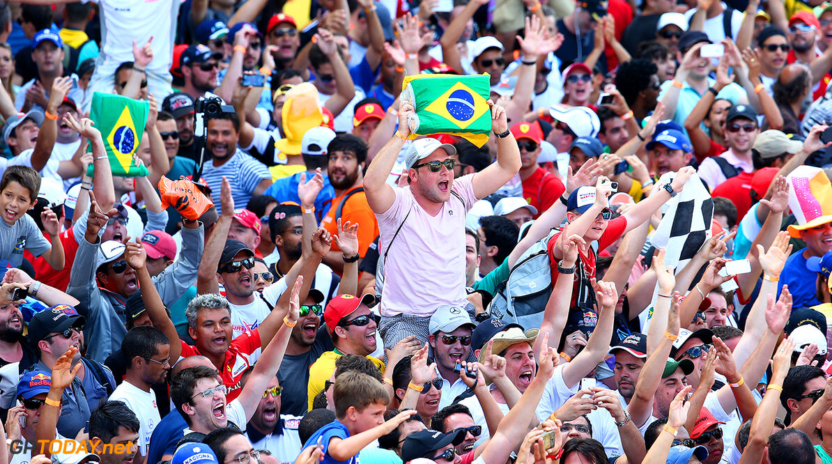 SAO PAULO, BRAZIL - NOVEMBER 09:  Fans enjoy the atmosphere in the pit lane after the Brazilian Formula One Grand Prix at Autodromo Jose Carlos Pace on November 9, 2014 in Sao Paulo, Brazil.  (Photo by Mark Thompson/Getty Images) F1 Grand Prix of Brazil Mark Thompson Sao Paulo Brazil  forumla one racing Interlagos