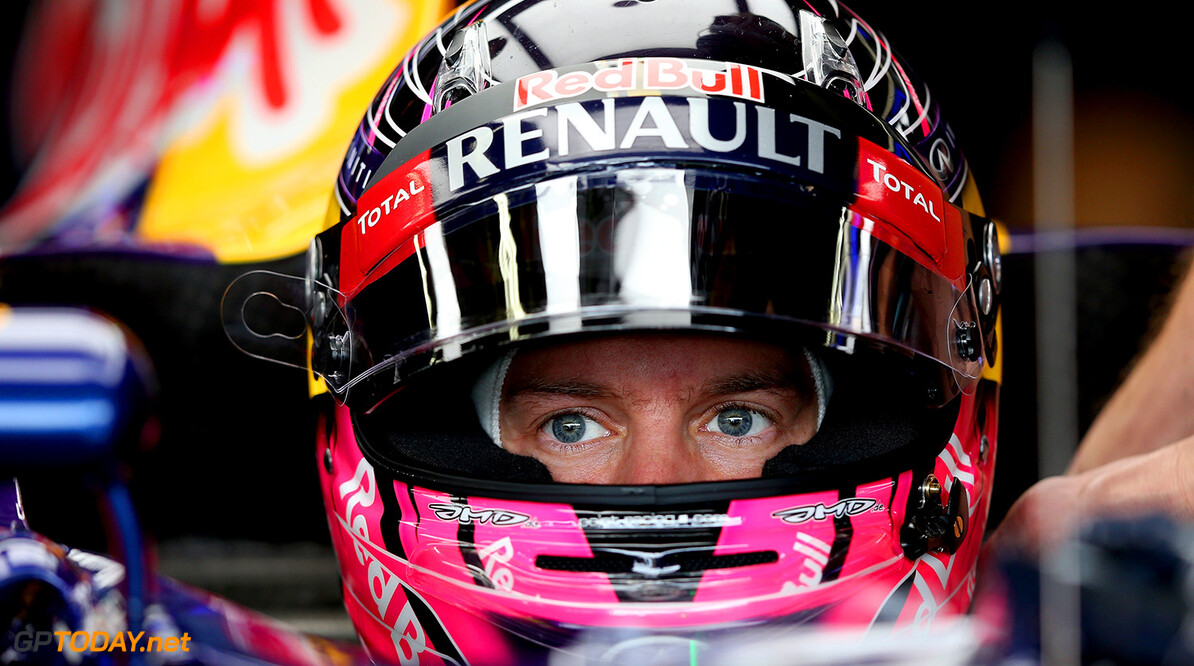 SAO PAULO, BRAZIL - NOVEMBER 08:  Sebastian Vettel of Germany and Infiniti Red Bull Racing sits in his car in the garage during final practice for the Brazilian Formula One Grand Prix at Autodromo Jose Carlos Pace on November 8, 2014 in Sao Paulo, Brazil.  (Photo by Matthew Stockman/Getty Images) *** Local Caption *** Sebastian Vettel F1 Grand Prix of Brazil - Qualifying Matthew Stockman Sao Paulo Brazil  forumla one racing Interlagos