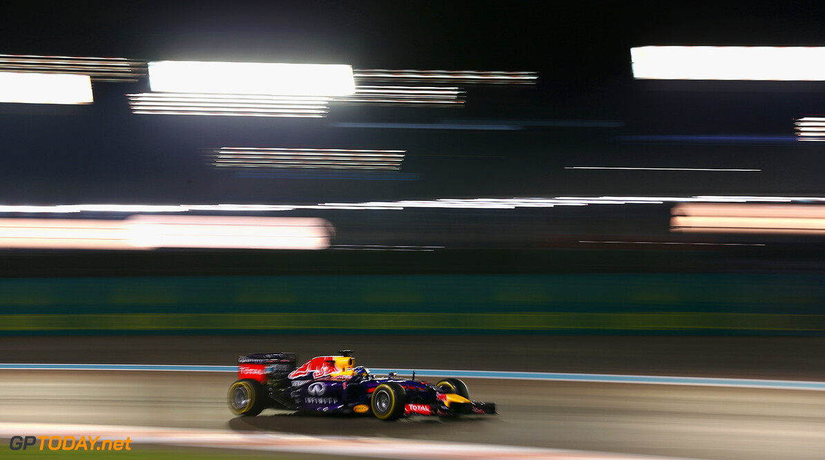 ABU DHABI, UNITED ARAB EMIRATES - NOVEMBER 21:  Sebastian Vettel of Germany and Infiniti Red Bull Racing drives during practice ahead of the Abu Dhabi Formula One Grand Prix at Yas Marina Circuit on November 21, 2014 in Abu Dhabi, United Arab Emirates.  (Photo by Clive Mason/Getty Images) *** Local Caption *** Sebastian Vettel F1 Grand Prix of Abu Dhabi - Practice Clive Mason Abu Dhabi United Arab Emirates  formula one racing