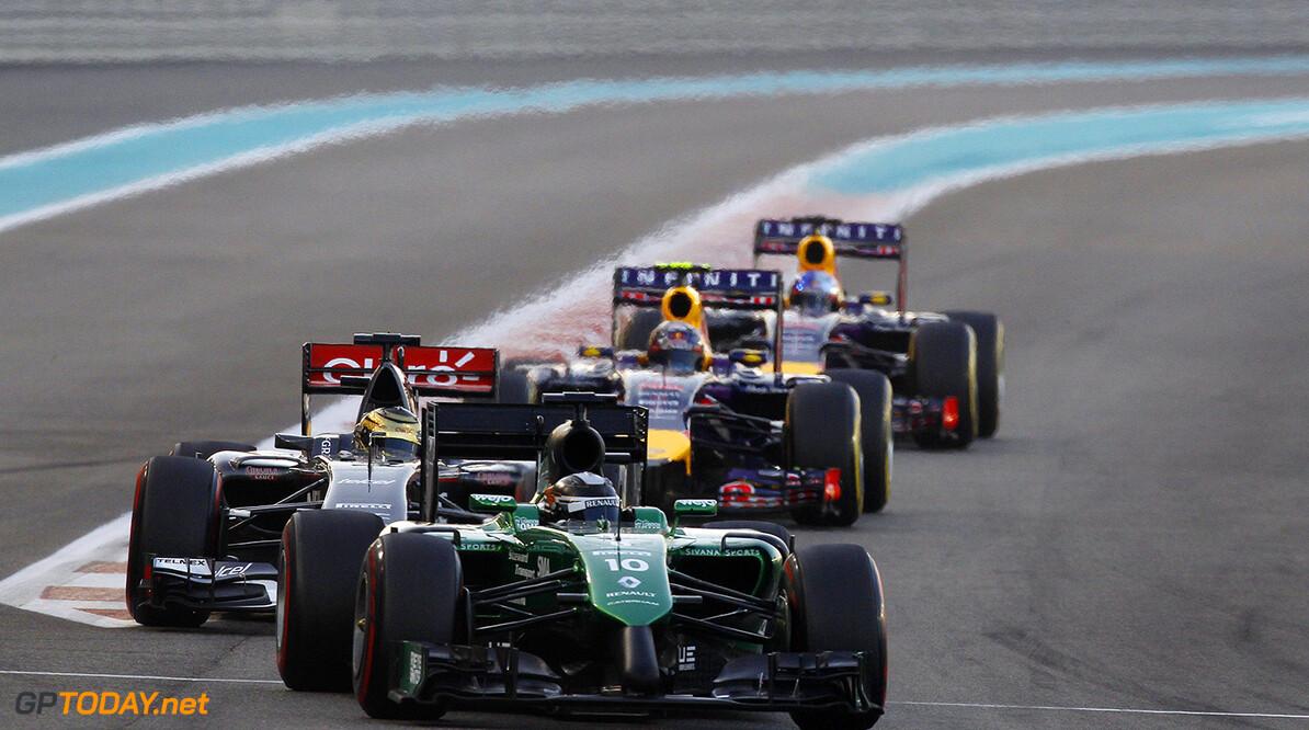 Yas Marina Circuit, Abu Dhabi, United Arab Emirates. Sunday 23 November 2014. Kamui Kobayashi, Caterham CT05 Renault. World Copyright: Sam Bloxham/LAT Photographic. ref: Digital Image _G7C2214  Sam Bloxham    formula 1 formula one f1 gp uae