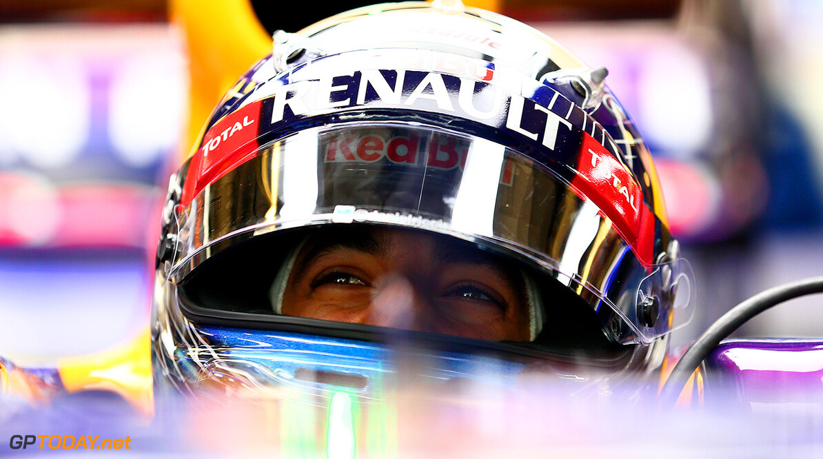 ABU DHABI, UNITED ARAB EMIRATES - NOVEMBER 26:  Daniel Ricciardo of Australia and Infiniti Red Bull Racing smiles as he sits in his car in the garage during day two of Formula One testing at Yas Marina Circuit on November 26, 2014 in Abu Dhabi, United Arab Emirates.  (Photo by Dan Istitene/Getty Images) *** Local Caption *** Daniel Ricciardo F1 Testing In Abu Dhabi - Day Two Dan Istitene Abu Dhabi United Arab Emirates  Formula One Racing