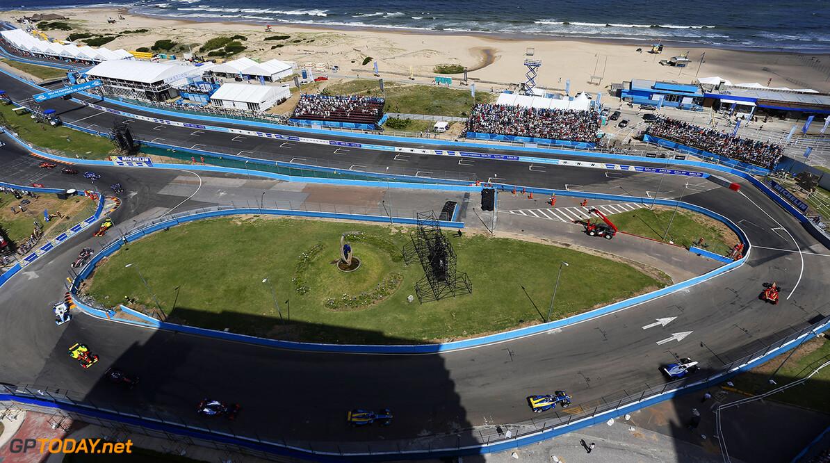 2014 FIA Formula E Championship. Punta del Este ePrix, Uruguay. Start. Nelson Piquet Jr (BRA)/China Racing - Spark-Renault SRT_01E leads Jean-Eric Vergne (FRA)/Andretti Motorsport - Spark-Renault SRT_01E, Sebastien Buemi (SWI)/E.dams Renault - Spark-Renault SRT_01E and Nicolas Prost (FRA)/E.dams Renault - Spark-Renault SRT_01E. Photo: Zak Mauger/LAT/FE ref: Digital Image _L0U1670  Zak Mauger