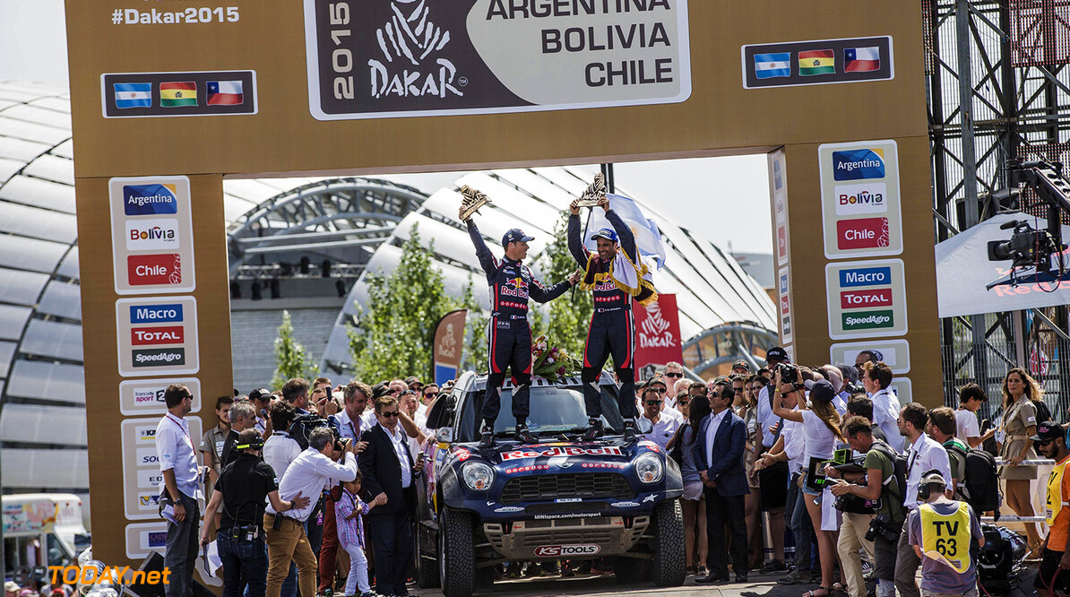 Nasser Al-Attiyah and Matthieu Baumel celebrate their victory on the podium of Technopolis on the Rally Dakar 2015 in Buenos Aires, Argentina on January 17th, 2015 // Flavien Duhamel/Red Bull Content Pool // P-20150117-00068 // Usage for editorial use only // Please go to www.redbullcontentpool.com for further information. //  Nasser Al-Attiyah and Matthieu Baumel - Lifestyle Flavien Duhamel    P-20150117-00068