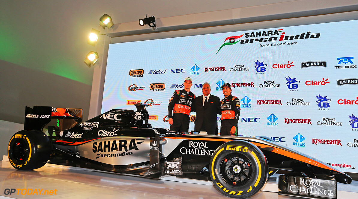 Sahara Force India F1 Team Livery Reveal (L to R): Nico Hulkenberg (GER) Sahara Force India F1 with Dr. Vijay Mallya (IND) Sahara Force India F1 Team Owner and Sergio Perez (MEX) Sahara Force India F1.