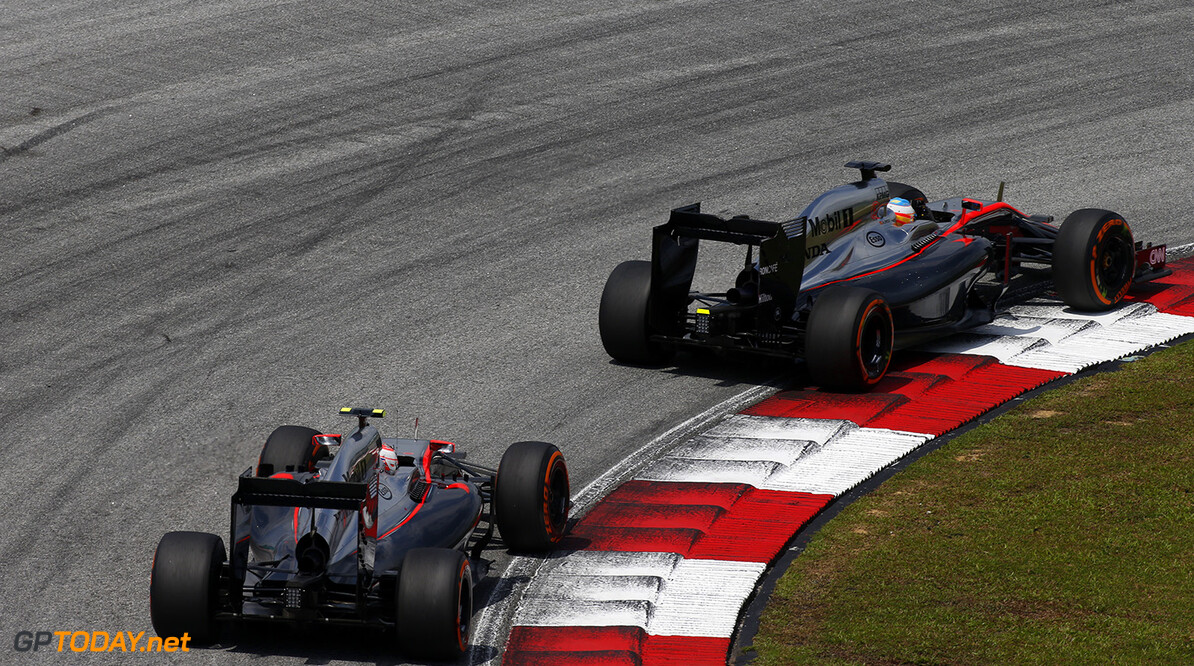 Fernando Alonso and Jenson Button on track.