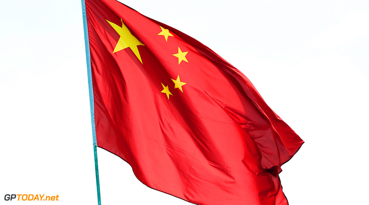 SHANGHAI, CHINA - APRIL 09:  The Chinese national flag flaps in the wind during previews to the Formula One Grand Prix of China at Shanghai International Circuit on April 9, 2015 in Shanghai, China.  (Photo by Dan Istitene/Getty Images) F1 Grand Prix of China - Previews Dan Istitene Shanghai China  Formula One Racing formula 1 Auto Racing Formula 1 Grand Prix of China Chinese Formula One Grand Prix Formula One Grand Prix