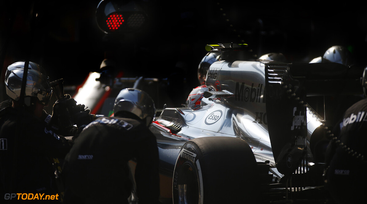 Jenson Button makes a pitstop.