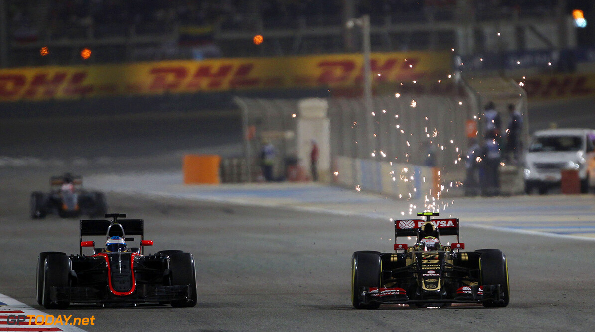 Formula One World Championship (L to R): Fernando Alonso (ESP) McLaren MP4-30 and Pastor Maldonado (VEN) Lotus F1 E23 battle for position.