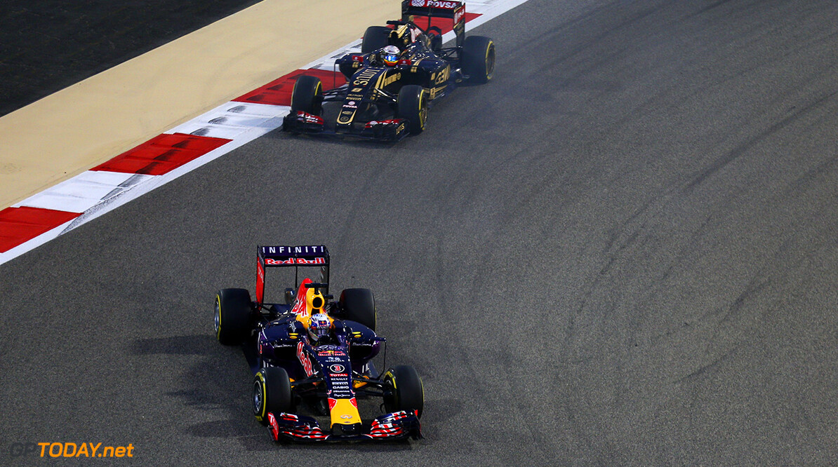 BAHRAIN, BAHRAIN - APRIL 19:  Daniel Ricciardo of Australia and Infiniti Red Bull Racing and Romain Grosjean of France and Lotus drive during the Bahrain Formula One Grand Prix at Bahrain International Circuit on April 19, 2015 in Bahrain, Bahrain.  (Photo by Clive Mason/Getty Images) // Getty Images/Red Bull Content Pool // P-20150419-00261 // Usage for editorial use only // Please go to www.redbullcontentpool.com for further information. //  F1 Grand Prix of Bahrain Clive Mason As Sakhir Bahrain  P-20150419-00261