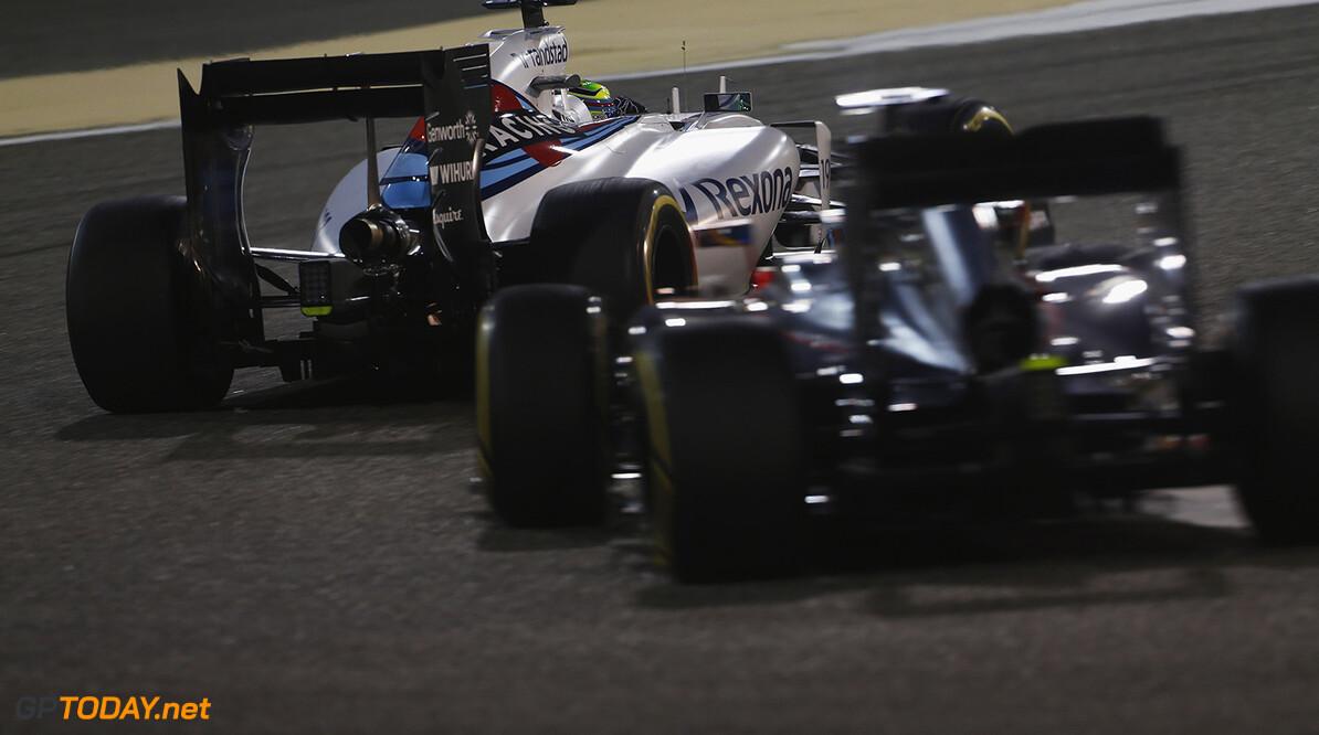 Bahrain International Circuit, Sakhir, Bahrain. Sunday 19 April 2015. Felipe Massa, Williams FW37 Mercedes, leads Fernando Alonso, McLaren MP4-30 Honda. Photo: Sam Bloxham/Williams ref: Digital Image _SBL9151  Sam Bloxham    Action