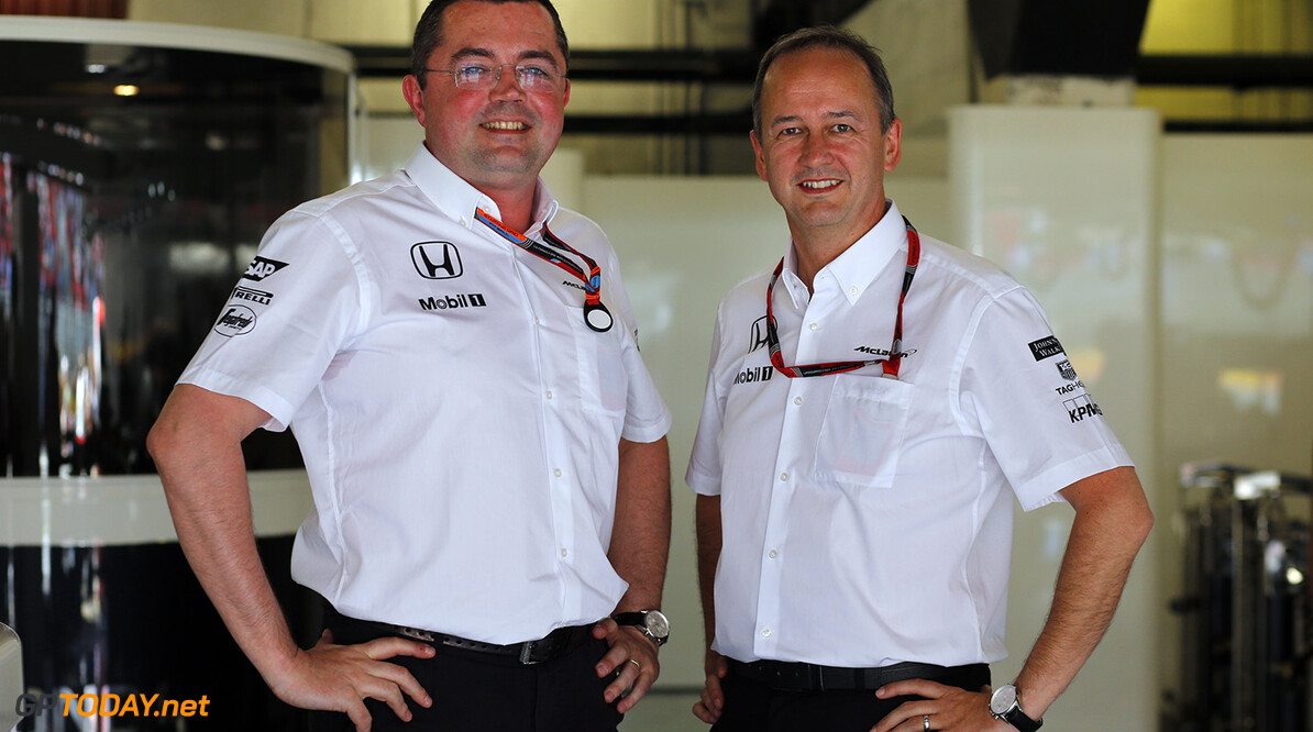 Eric Boullier and Jonathan Neale in the garage.  Steven Tee