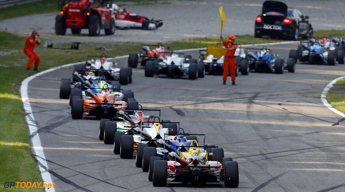 FIA Formula 3 European Championship, round 4, race 2, Monza Marshals with yellow flags, FIA Formula 3 European Championship, round 4, race 2, Monza (ITA) - 29. - 31. May 2015 FIA Formula 3 European Championship, round 4, race 2, Monza (ITA) Thomas Suer Monza Italy