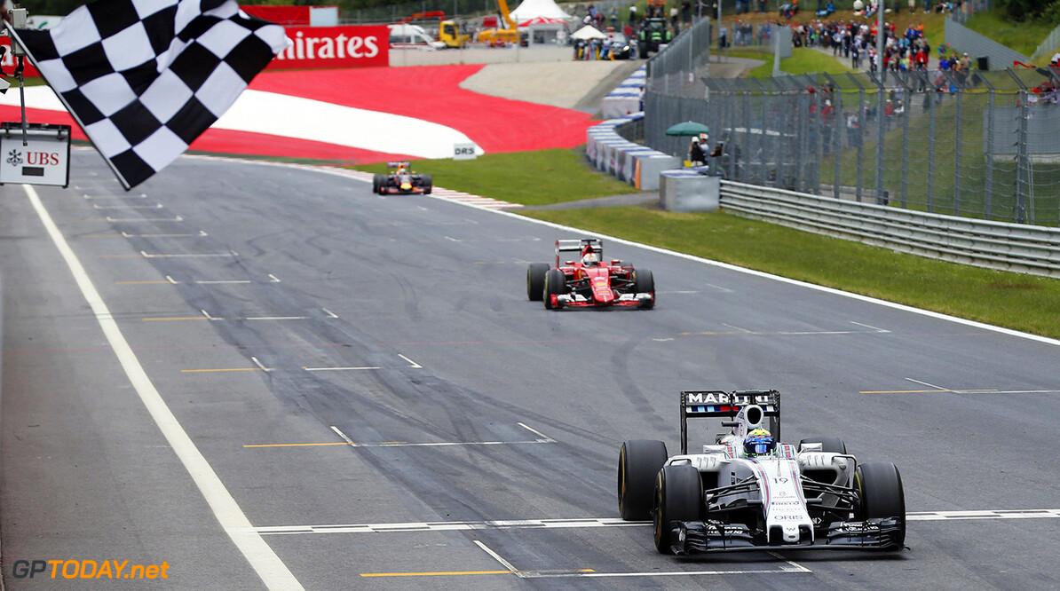 Circuit Gilles Villeneuve, Montreal, Canada. Sunday 21 June 2015. Felipe Massa, Williams FW37 Mercedes, 3rd Position, passes the chequered flag. Photo: Glenn Dunbar/Williams ref: Digital Image WW2Q3872      Action Finish