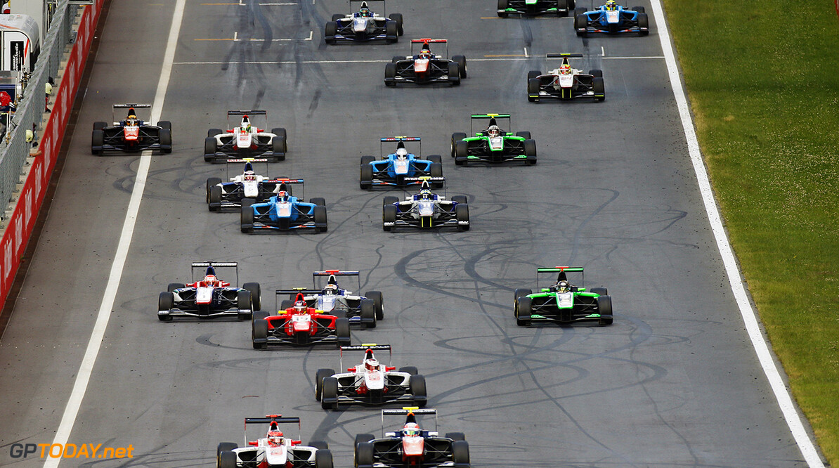 2015 GP3 Series Round 2.  Red Bull Ring, Spielberg, Austria.  Saturday 20 June 2015. Esteban Ocon (FRA, ART Grand Prix) leads Luca Ghiotto (ITA, Trident) and the rest of the field at the start Photo: Sam Bloxham/GP3 Media Service  ref: Digital Image _W2Q2999      race Action