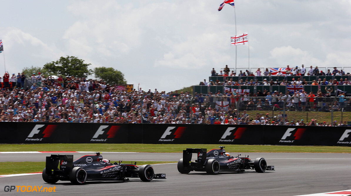 Fernando Alonso leads Jenson Button.