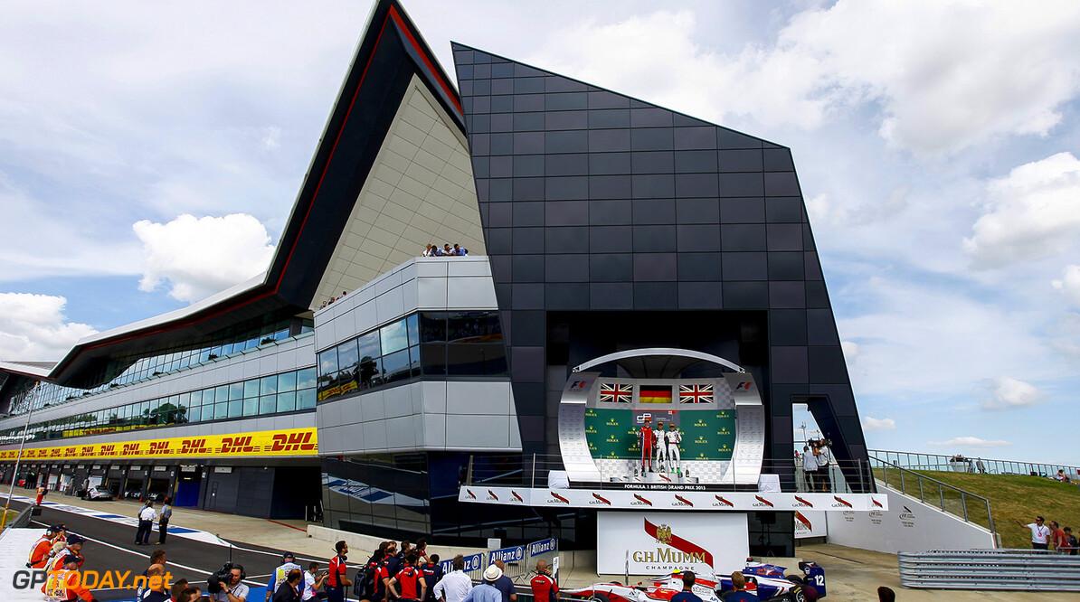 2015 GP3 Series Round 3. Silverstone, Northamptonshire, England. Saturday 4 July 2015. Emil Bernstorff (GBR, Arden International), Marvin Kirchhofer (GER, ART Grand Prix) and Matthew Parry (GBR, Koiranen GP) on the podium. Photo: Zak Mauger/GP3 Series Media Service. ref: Digital Image _MG_0880   Zak Mauger    Race One 1 race