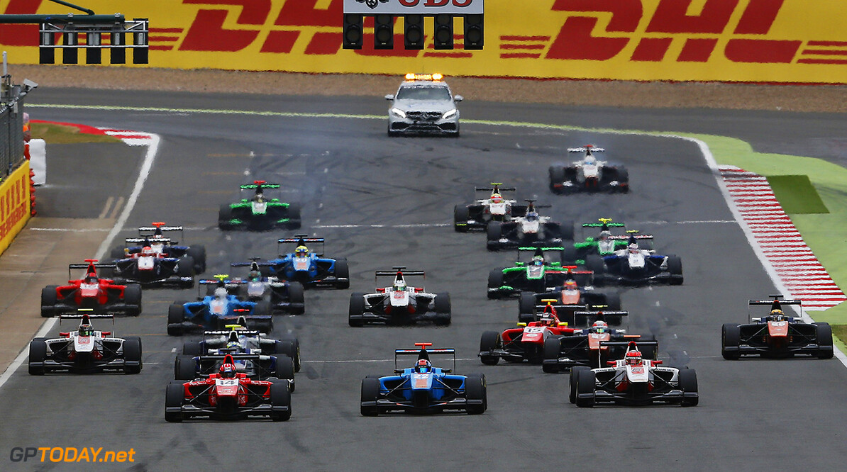 2015 GP3 Series Round 3. Silverstone, Northamptonshire, England. Sunday 5 July 2015. Kevin Ceccon (ITA, Arden International) leads Ralph Boschung (SUI, Jenzer Motorsport) and the rest of the field at the start of the race. Photo: Zak Mauger/GP3 Series Media Service. ref: Digital Image _L0U4827   Zak Mauger    Race Two 2 action