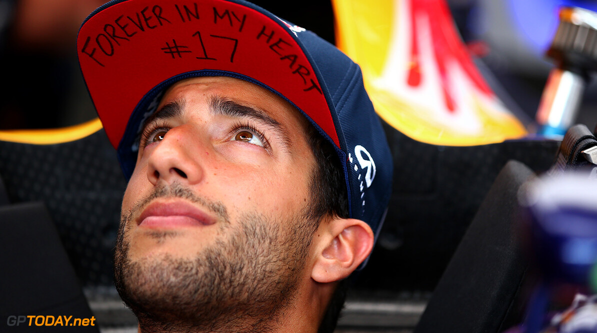 BUDAPEST, HUNGARY - JULY 23:  Daniel Ricciardo of Australia and Infiniti Red Bull Racing sits in his car in the garage wearing a cap displaying a message in memory of Jules Bianchi during previews to the Formula One Grand Prix of Hungary at Hungaroring on July 23, 2015 in Budapest, Hungary.  (Photo by Mark Thompson/Getty Images) // Getty Images/Red Bull Content Pool // P-20150723-00172 // Usage for editorial use only // Please go to www.redbullcontentpool.com for further information. //  F1 Grand Prix of Hungary - Previews Mark Thompson Budapest Hungary  P-20150723-00172