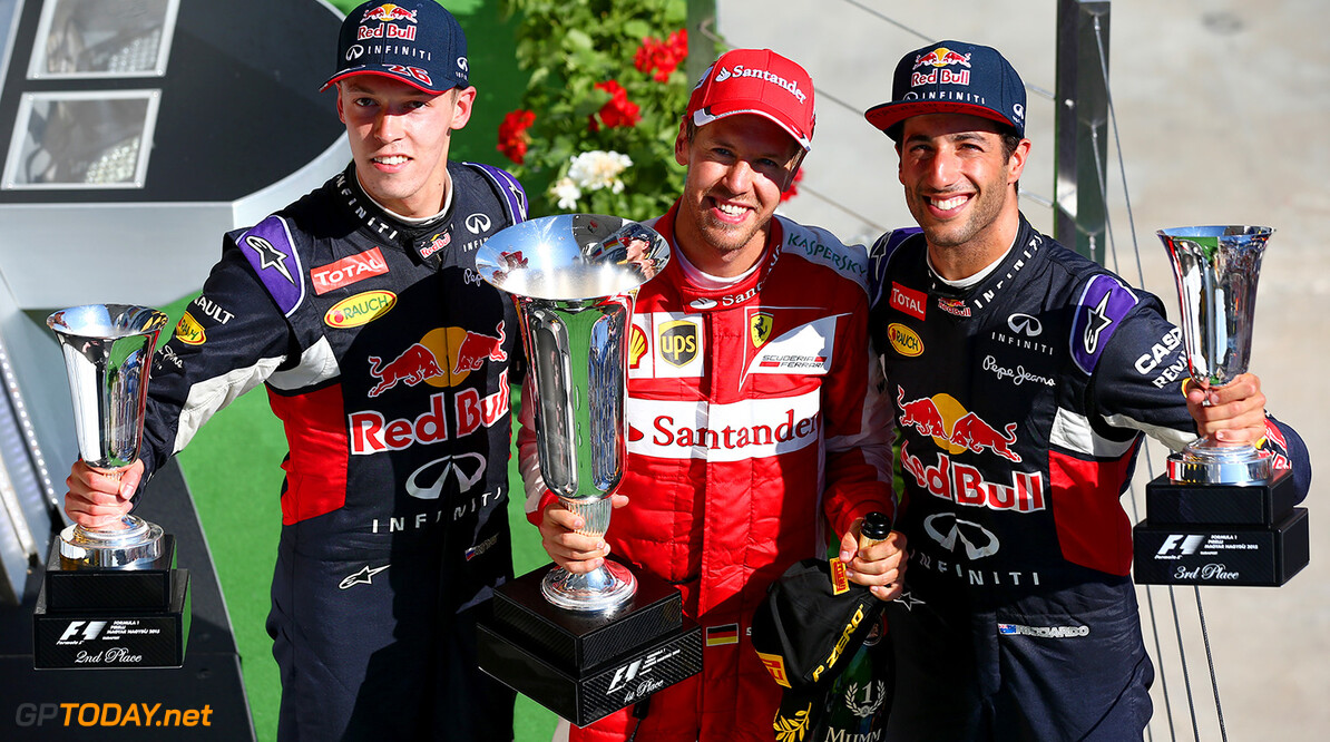 BUDAPEST, HUNGARY - JULY 26:  Sebastian Vettel of Germany and Ferrari celebrates on the podium next to Daniel Ricciardo of Australia and Infiniti Red Bull Racing, Daniil Kvyat of Russia after winning the Formula One Grand Prix of Hungary at Hungaroring on July 26, 2015 in Budapest, Hungary.  (Photo by Mark Thompson/Getty Images) // Getty Images/Red Bull Content Pool // P-20150726-00231 // Usage for editorial use only // Please go to www.redbullcontentpool.com for further information. //  F1 Grand Prix of Hungary Mark Thompson Budapest Hungary  P-20150726-00231