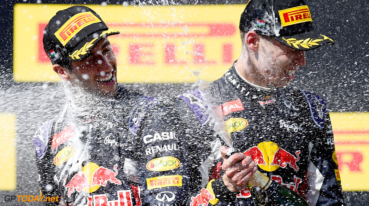 BUDAPEST, HUNGARY - JULY 26:  Daniel Ricciardo of Australia and Infiniti Red Bull Racing and Daniil Kvyat of Russia and Infiniti Red Bull Racing celebrate on the podium after finsihing third and second during the Formula One Grand Prix of Hungary at Hungaroring on July 26, 2015 in Budapest, Hungary.  (Photo by Lars Baron/Getty Images) // Getty Images/Red Bull Content Pool // P-20150726-00248 // Usage for editorial use only // Please go to www.redbullcontentpool.com for further information. //  F1 Grand Prix of Hungary Lars Baron Budapest Hungary  P-20150726-00248