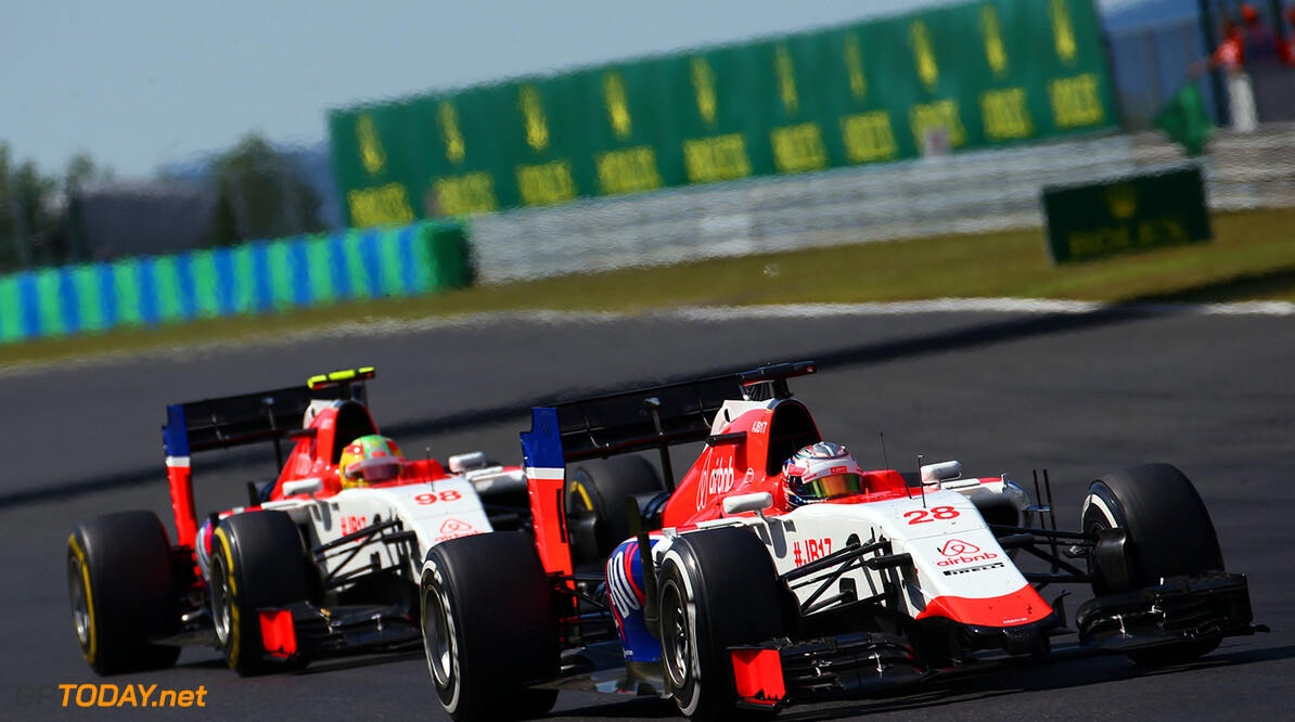 Formula One World Championship Will Stevens (GBR) Manor Marussia F1 Team leads team mate Roberto Merhi (ESP) Manor Marussia F1 Team.