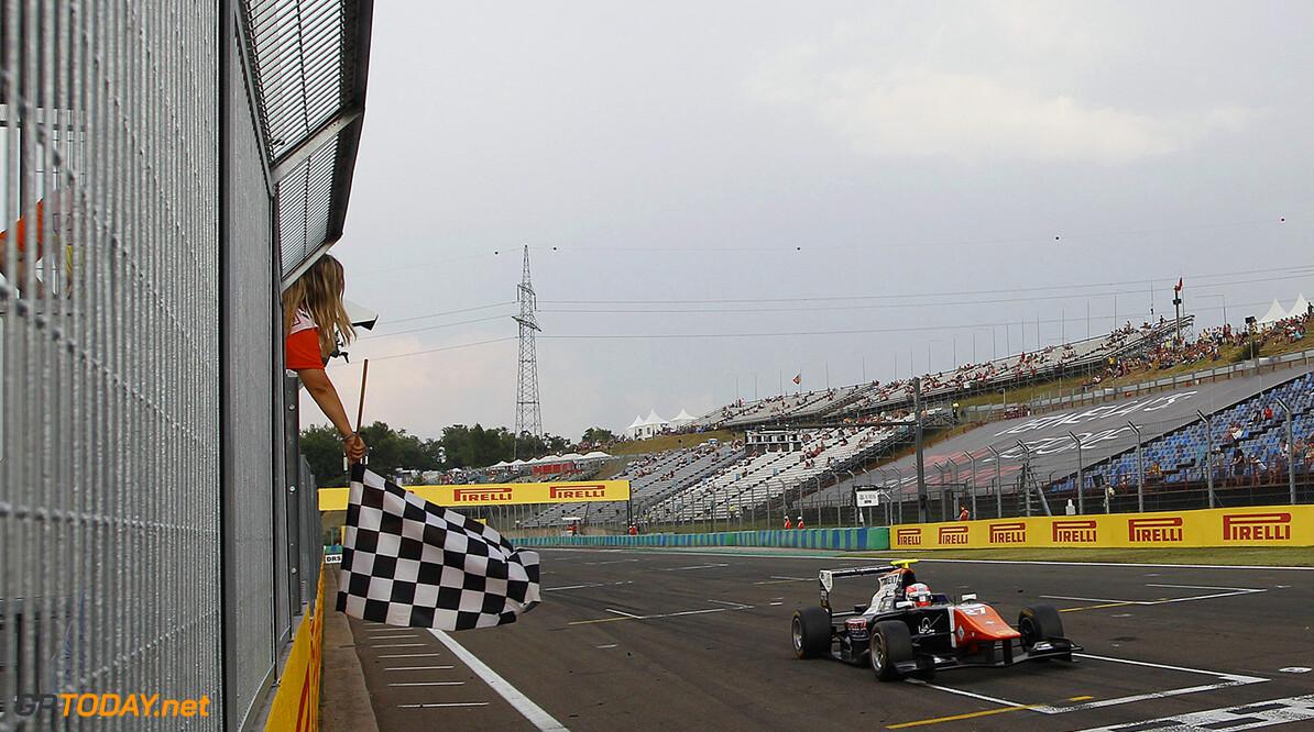 2015 GP3 Series Round 4. Hungaroring, Budapest, Hungary.  Saturday 25 July 2015. Luca Ghiotto (ITA, Trident) crosses the line to take the win. Photo:  Sam Bloxham/GP3 Media Service ref: Digital Image _G7C3318      race action