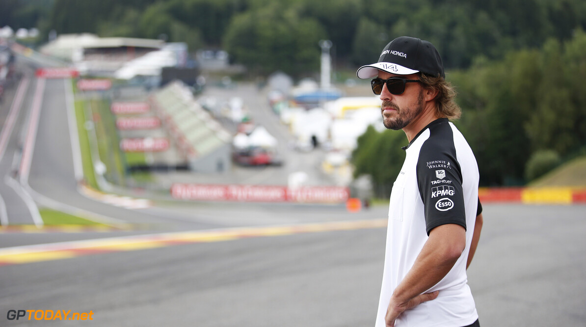 Fernando Alonso surveys Eau Rouge from the side of the track.