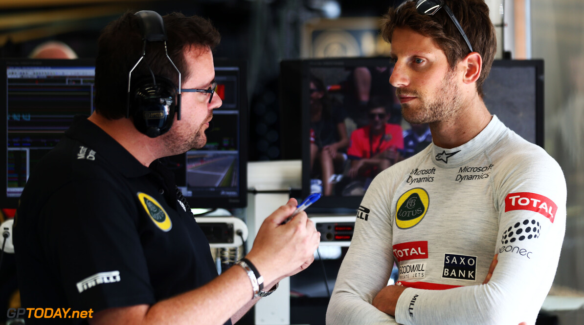 Formula One World Championship (L to R): Julien Simon-Chautemps (FRA) Lotus F1 Team Race Engineer with Romain Grosjean (FRA) Lotus F1 Team.