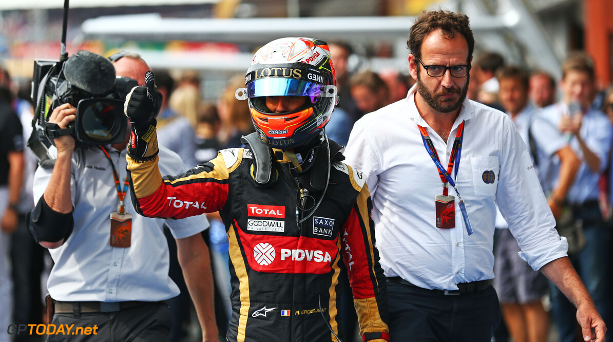 Formula One World Championship Romain Grosjean (FRA) Lotus F1 Team celebrates his third position in parc ferme.