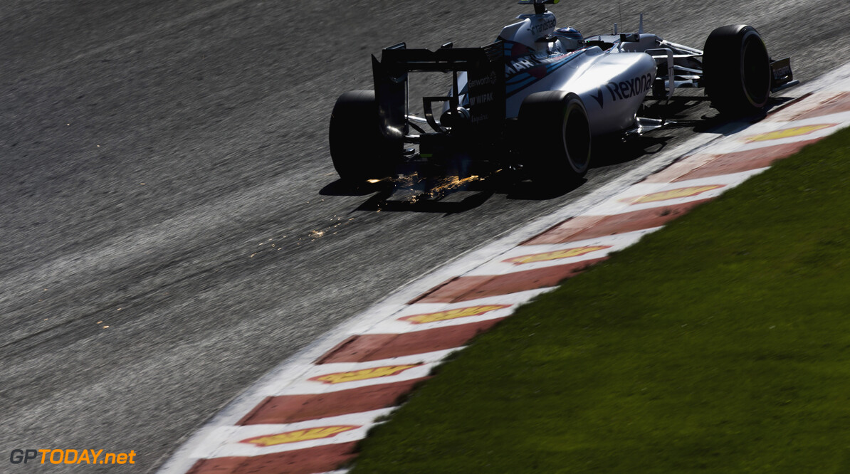 Spa-Francorchamps, Spa, Belgium. Saturday 22 August 2015. Sparks fly from the underside of Valtteri Bottas, Williams FW37 Mercedes. Photo: Zak Mauger/Williams ref: Digital Image WL0U1304  Zak Mauger    Action