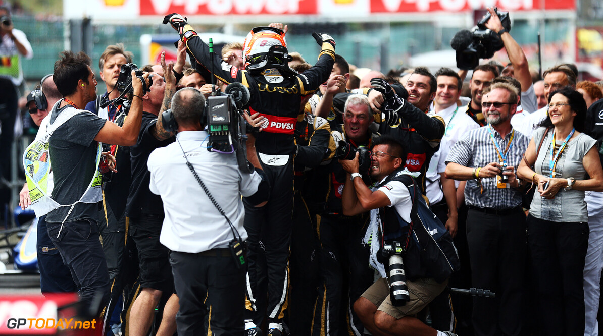 Formula One World Championship Romain Grosjean (FRA) Lotus F1 Team celebrates his third position with the team at parc ferme.