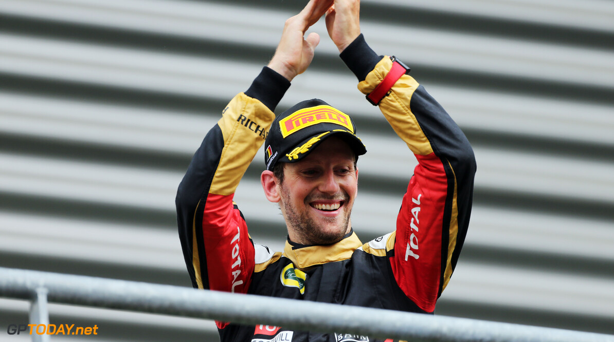 Formula One World Championship Romain Grosjean (FRA) Lotus F1 Team celebrates his third position on the podium.