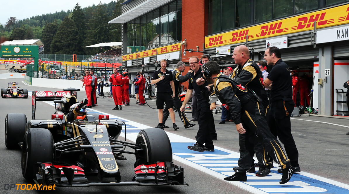 Formula One World Championship Romain Grosjean (FRA) Lotus F1 E23 celebrates his third position with the team at the end of the race.