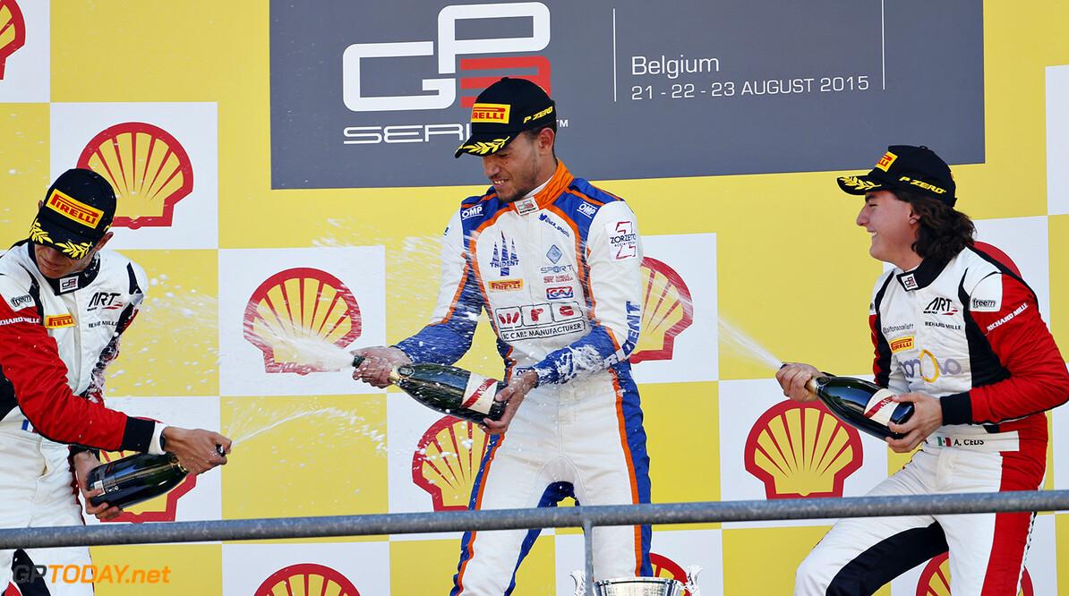 2015 GP3 Series Round 5.  Spa-Francorchamps, Spa, Belgium.  Sunday 23 August 2015. Luca Ghiotto (ITA, Trident), celebrates on the podium with Esteban Ocon (FRA, ART Grand Prix) and 4. Photo: Sam Bloxham/GP3 Series Media Service ref: Digital Image _SBL9023      race portrait