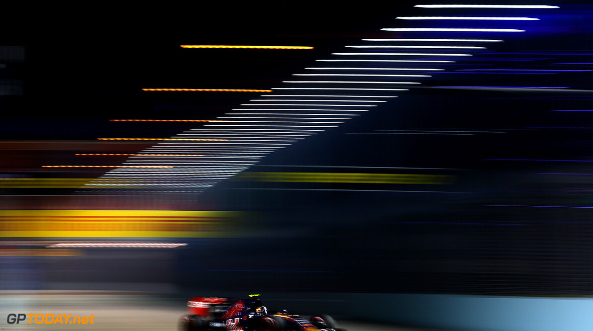 SINGAPORE - SEPTEMBER 18:  Carlos Sainz of Spain and Scuderia Toro Rosso drives during practice for the Formula One Grand Prix of Singapore at Marina Bay Street Circuit on September 18, 2015 in Singapore.  (Photo by Clive Mason/Getty Images) // Getty Images/Red Bull Content Pool // P-20150918-00581 // Usage for editorial use only // Please go to www.redbullcontentpool.com for further information. //  F1 Grand Prix of Singapore - Practice Clive Mason Singapore Singapore  P-20150918-00581