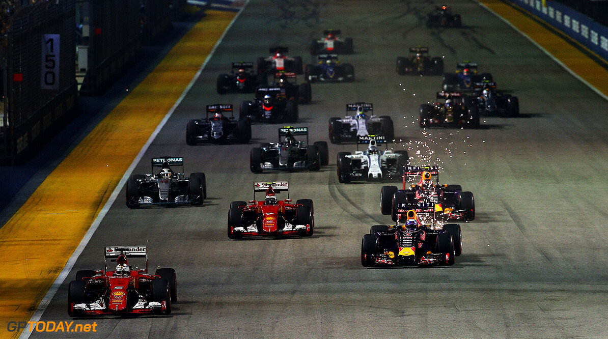SINGAPORE - SEPTEMBER 20:  Sebastian Vettel of Germany and Ferrari leads Daniel Ricciardo of Australia and Infiniti Red Bull Racing, Kimi Raikkonen of Finland and Ferrari, Daniil Kvyat of Russia and Infiniti Red Bull Racing and Lewis Hamilton of Great Britain and Mercedes GP into the first corner during the Formula One Grand Prix of Singapore at Marina Bay Street Circuit on September 20, 2015 in Singapore.  (Photo by Mark Thompson/Getty Images) // Getty Images/Red Bull Content Pool // P-20150920-00629 // Usage for editorial use only // Please go to www.redbullcontentpool.com for further information. //  F1 Grand Prix of Singapore Mark Thompson Singapore Singapore  P-20150920-00629
