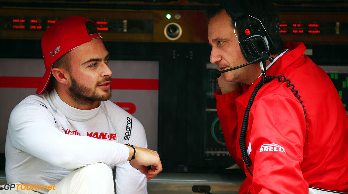 Formula One World Championship (L to R): Will Stevens (GBR) Manor Marussia F1 Team with Gianluca Pisanello (ITA) Manor Marussia F1 Team Chief Engineer on the pit gantry.