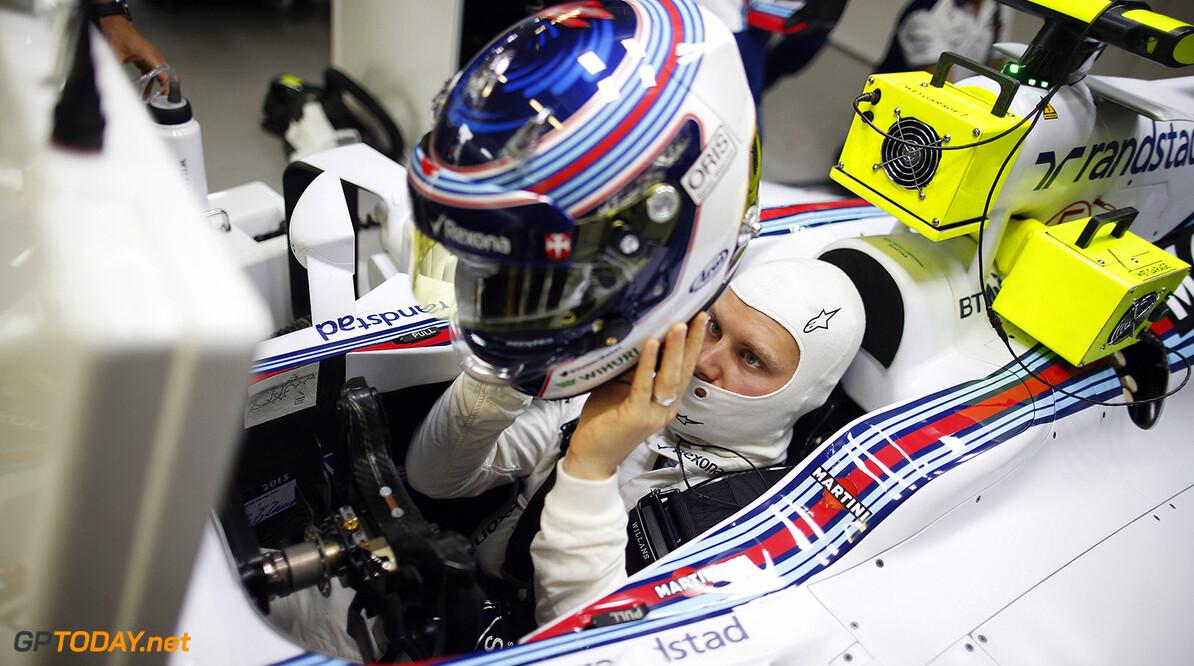 Suzuka Circuit, Suzuka, Japan. Friday 25 September 2015. Valtteri Bottas, Williams F1, puts his helmet on. Photo: Glenn Dunbar/Williams ref: Digital Image W89P0275      Portrait Helmets
