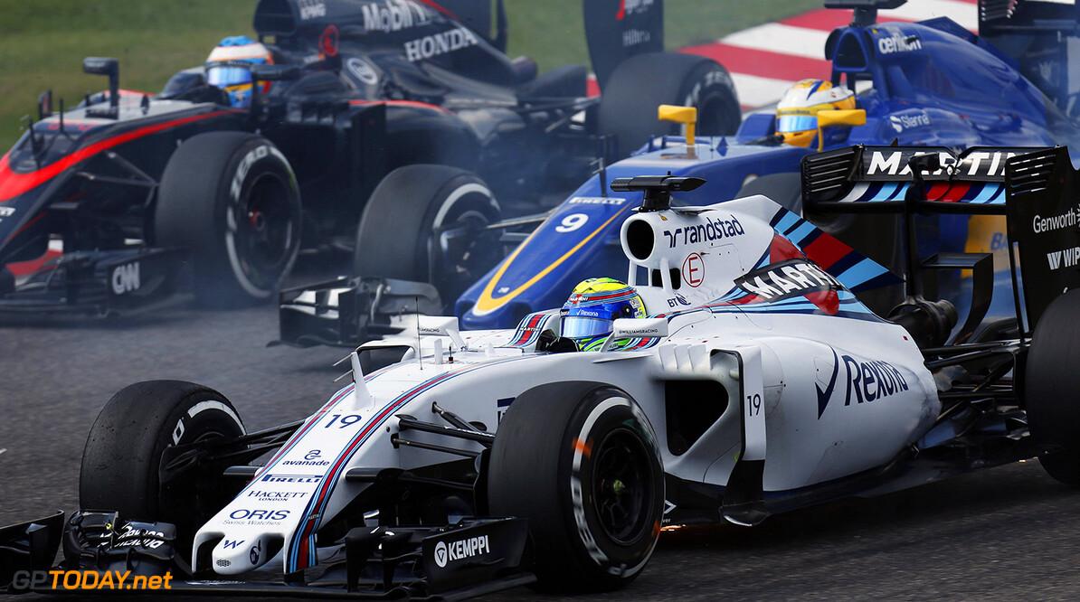 Suzuka Circuit, Suzuka, Japan. Sunday 27 September 2015. Felipe Massa, Williams FW37 Mercedes, leads Marcus Ericsson, Sauber C34 Ferrari, and Fernando Alonso, McLaren MP4-30 Honda. Photo: Alastair Staley/Williams ref: Digital Image W79P7586      Action