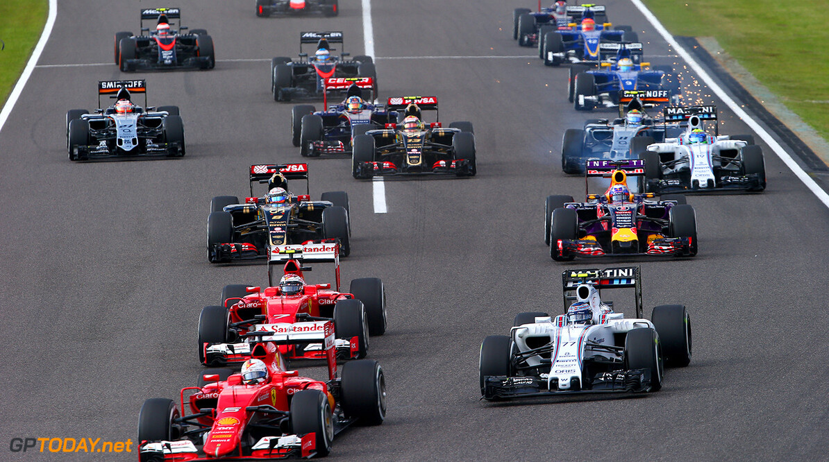 SUZUKA, JAPAN - SEPTEMBER 27:  Sebastian Vettel of Germany and Ferrari, Valtteri Bottas of Finland and Williams, Kimi Raikkonen of Finland and Ferrari and Daniel Ricciardo of Australia and Infiniti Red Bull Racing drive in to the first corner during the Formula One Grand Prix of Japan at Suzuka Circuit on September 27, 2015 in Suzuka, Japan.  (Photo by Mark Thompson/Getty Images) // Getty Images/Red Bull Content Pool // P-20150927-00232 // Usage for editorial use only // Please go to www.redbullcontentpool.com for further information. //  F1 Grand Prix of Japan Mark Thompson Suzuka Japan  P-20150927-00232