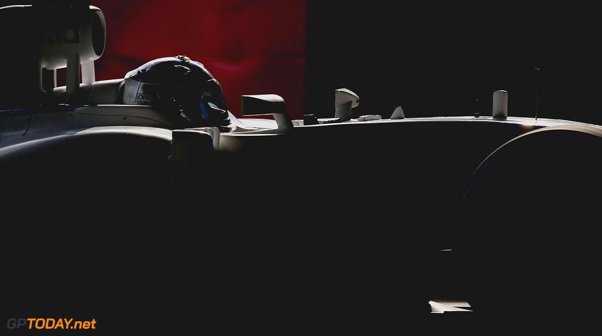 Suzuka Circuit, Suzuka, Japan. Sunday 27 September 2015. Valtteri Bottas, Williams F1. Photo: Glenn Dunbar/Williams ref: Digital Image WW2Q2509      Portrait Helmets
