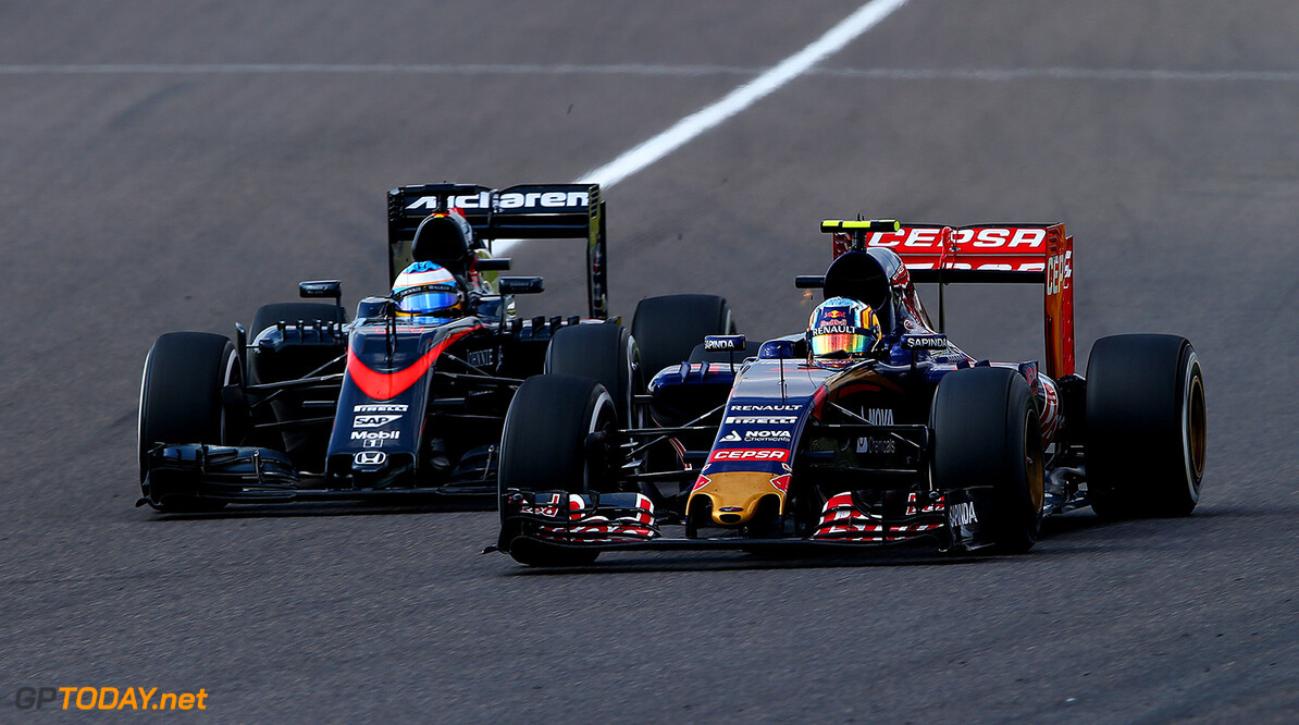 SUZUKA, JAPAN - SEPTEMBER 27:  Carlos Sainz of Spain and Scuderia Toro Rosso drives ahead of Fernando Alonso of Spain and McLaren Honda during the Formula One Grand Prix of Japan at Suzuka Circuit on September 27, 2015 in Suzuka, Japan.  (Photo by Mark Thompson/Getty Images) // Getty Images/Red Bull Content Pool // P-20150927-00419 // Usage for editorial use only // Please go to www.redbullcontentpool.com for further information. //  F1 Grand Prix of Japan Mark Thompson Suzuka Japan  P-20150927-00419