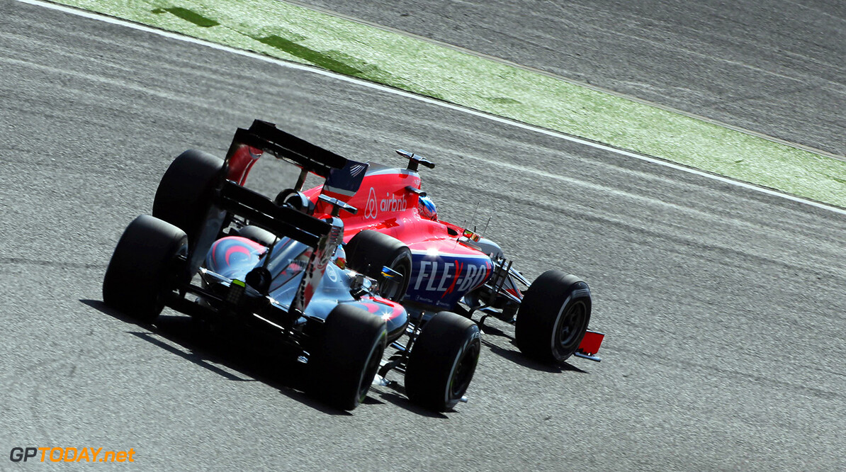 Formula One World Championship Will Stevens (GBR) Manor Marussia F1 Team leads Fernando Alonso (ESP) McLaren MP4-30.